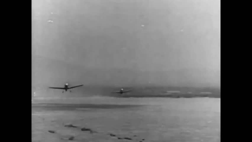 CIRCA 1941 - The Flying Tigers fight off the Imperial Japanese Air Force over Kunming (narrated in 1953).
