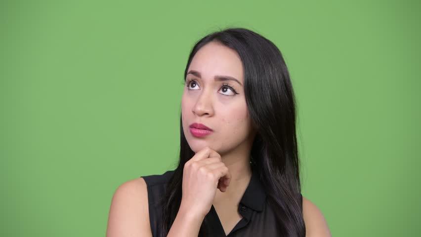 Young beautiful Asian businesswoman thinking | Shutterstock HD Video #1013619203