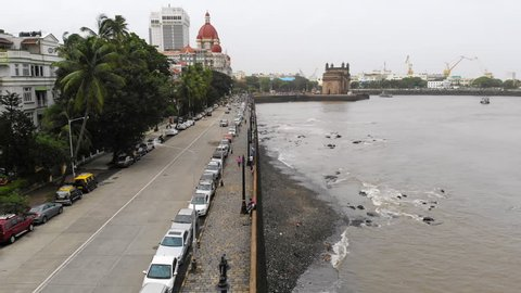 Aerial panoramic view of cityscape of Mumbai (Bombay) during monsoon season, Gateway of India monument on horizon - capital city of Maharashtra, landscape panorama of India, Asia from above