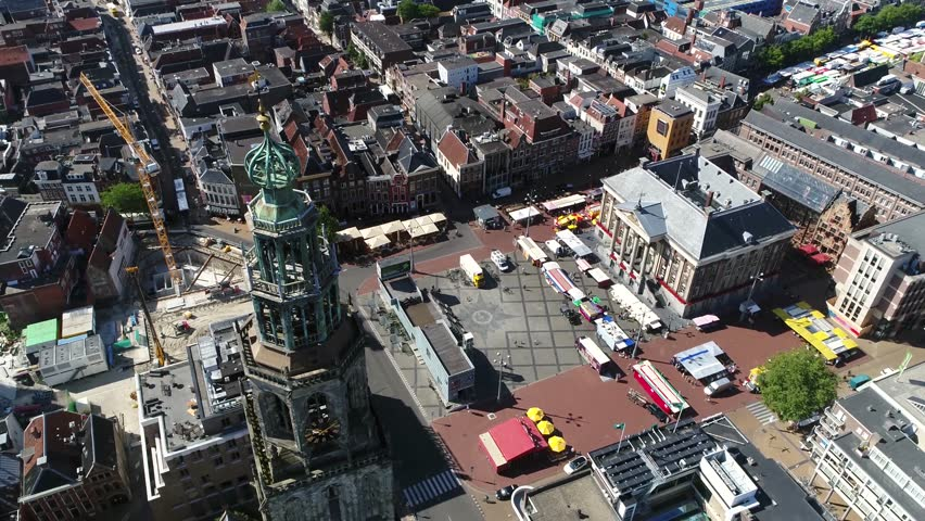 Aerial Grote Markt and Martinitoren highest church steeple in city of Groningen Netherlands and bell tower of Martinikerk it is located at the north-eastern corner of Grote Markt Main Market Square 4k