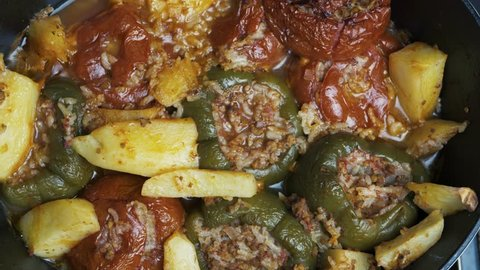Greek traditional summer dish called Gemista. It is vegetables, usually tomatoes and peppers, stuffed with rice and ground meat. Cooked with potatoes in an oven.