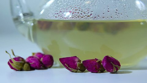 Tea EvaDia Mei Gui Hua Bao, Rose buds close-up. Flower and herbal tea, Mei Gui Hua. This drink can also be called herbal infusions, or tisanes. A light, floral, exotic tea. Wellness and Detox.