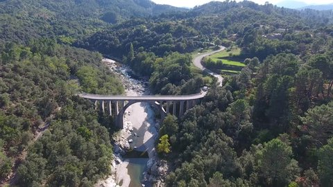 Drone shot flying toward a bridge in south of France. Sunny day