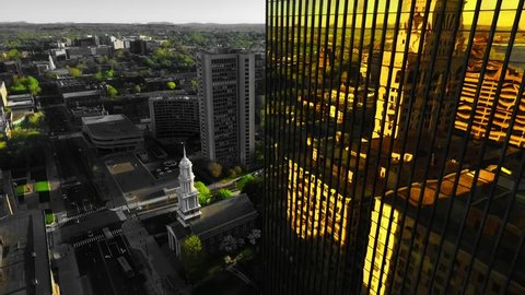 Hartford, Connecticut / United States - 08 15 2017: HARTFORD - CONNECTICUT - 2017: A fly over of the city of Hartford. Capturing the Gold Building on Gold St.