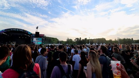 Paris, France - 06 22 2018: outdoor music festival crowd of people dancing during sunset, Solidays 2018