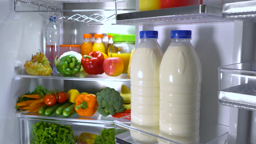 Open refrigerator filled with food. Healthy food.   Shutterstock HD Video #1013810753