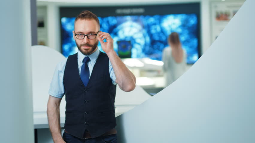 Portrait of confident businessman or programmer in the modern office or lab. Future technologies concept | Shutterstock HD Video #1013816603