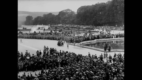 CIRCA 1919 - The crowded gardens of Versailles are shown before the Paris Peace Conference starts.