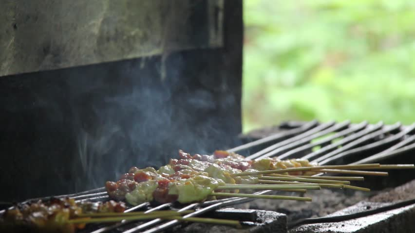 Merchant roasting barbeque for customers