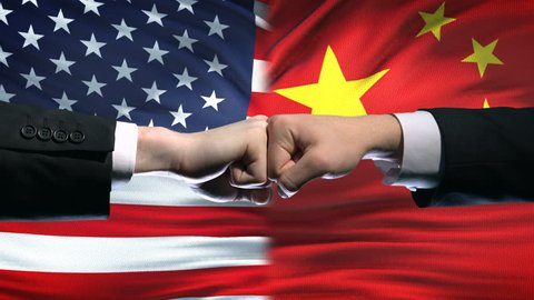 US vs China conflict, international relations crisis, fists on flag background