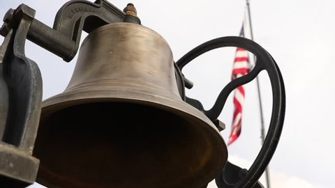 School Bell facing American flag in Paisley, Oregon