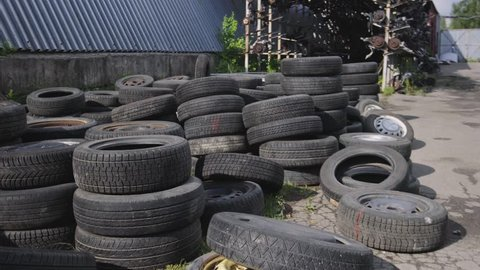 A bunch of tires with wheels and without.