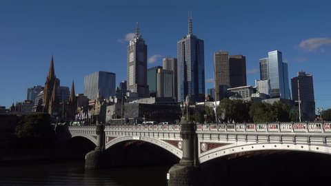 Melbourne skyline and Princes Bridge on a sunny day with blue sky