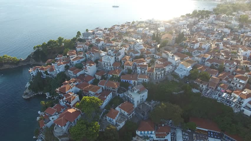 Aerial view of beautiful greek island and town, Skiathos. Bird's eye view of Skiathos old town, Greece, during sunny summer day.