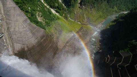 Drainage and rainbow of Kurobe dam, japan