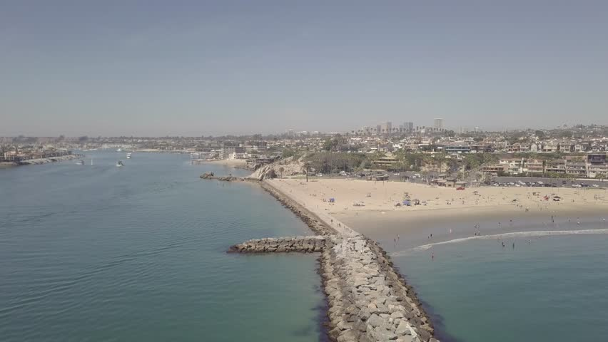 Corona Del Mar State Beach - Orange County, California  The Newport Beach Peninsula, Corona Del Mar Beach, and Entrance-way to Newport Harbor on a beautiful Clear Summer Day.