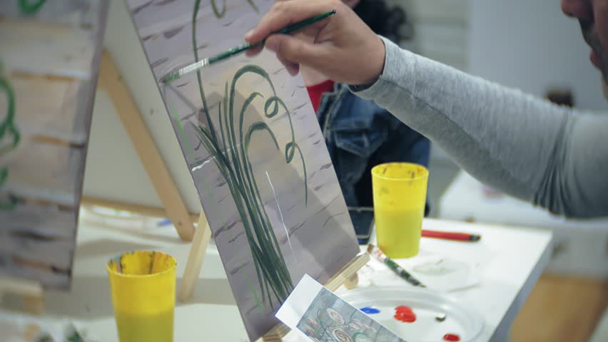 art school, creativity and people concept - group of students with easels, paintbrushes and palettes painting still life at studio, old and young people draw 4k