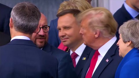 2018 - U.S. president Donald Trump jokes with Belgian PM Charles Michel and Luxembourg Xavier Bettel at the NATO summit in Brussels, Belgium.