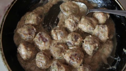 Meatballs on a skillet. Balls from chopped meat are ready for use