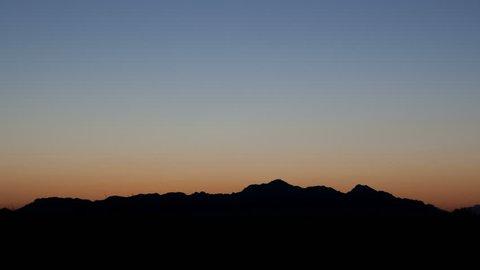 Sunrise 4K time lapse behind a mountain range in Eloy, Arizona