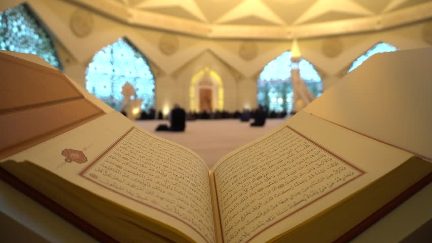 A Man Is Reading Quran Or Koran On The Reading Desk In A Mosque. | Shutterstock HD Video #1014138113