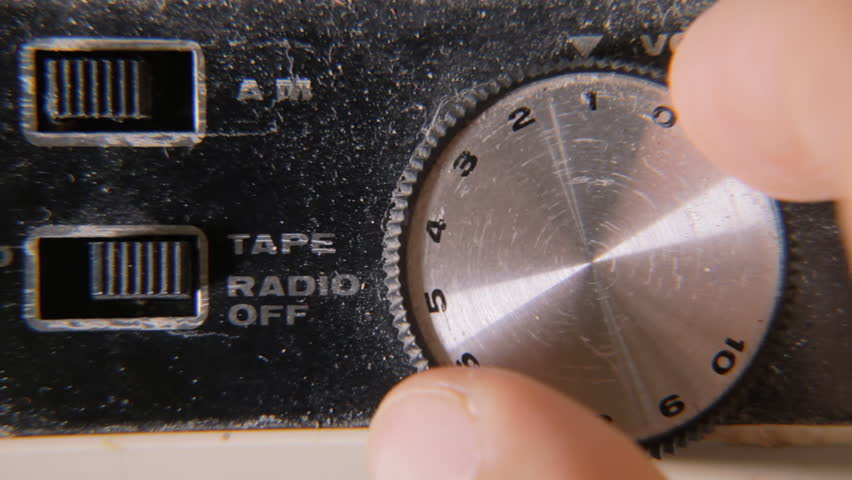 Shifting the dialer volume from ten to zero on a damaged old retro vintage cassette tape player.  | Shutterstock HD Video #1014139073