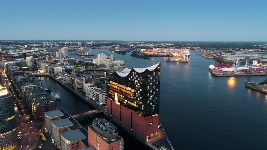 Aerial View of Elbphilharmonie and HafenCity at sunset, Hamburg, Hanseatic City. City lit up at night, Hamburg, Germany Night city landscape. Amazing architecture.