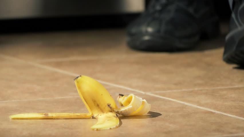 Slipping on banana peel and falling down closeup
