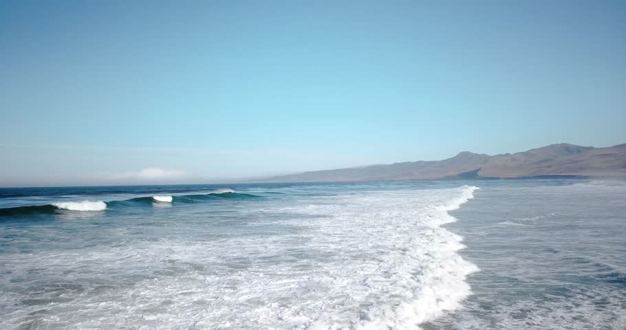 Coastline horizon footage with powerful waves crashing on sunny California beach.  | Shutterstock HD Video #1014215153