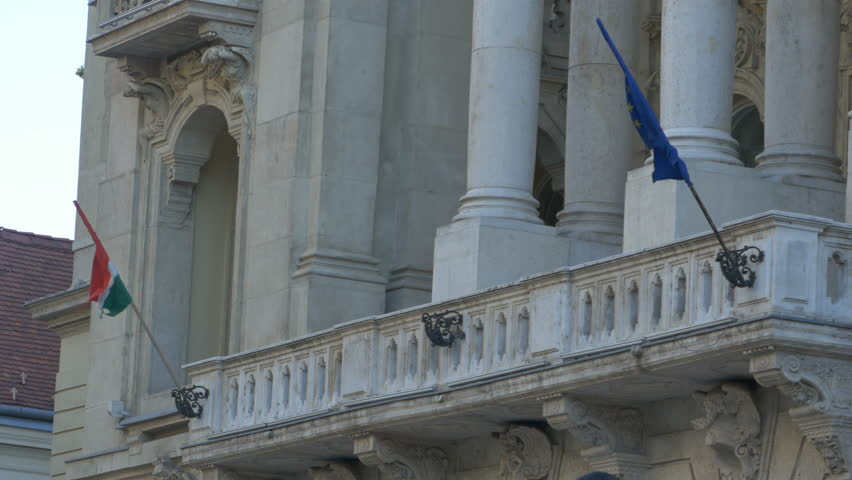 Hungary and European Union flags on an administrative building in Budapest, Hungary.