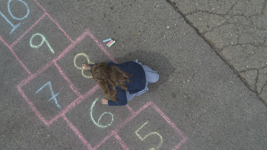 Rising aerial view of girl drawing hopscotch game in street then playing / Pleasant Grove, Utah, United States | Shutterstock HD Video #1014239723
