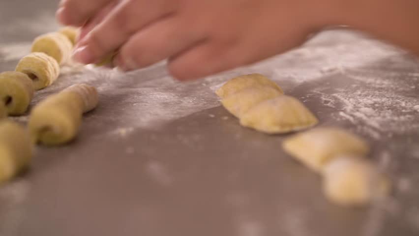 4K cooking footage, close up preparing italian gnocchi on kitchen work top