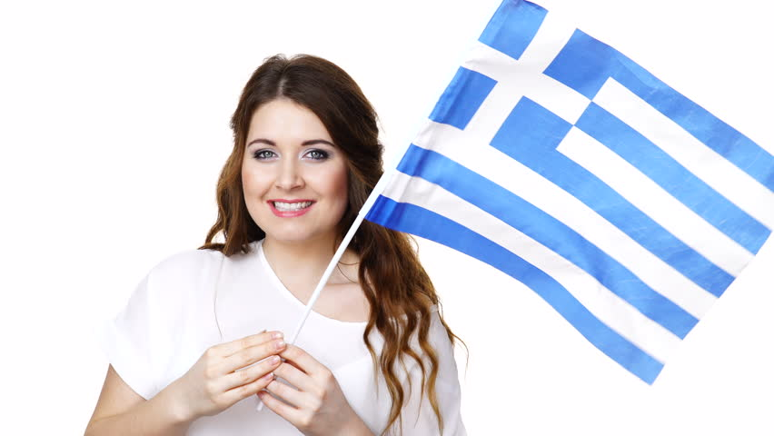 Brunette curly long hair young woman with greek flag making welcome invitating hand sign gesture,  let's go, isolated on white.