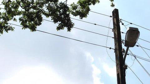 Telephone pole. Blue sky. Street lamp.