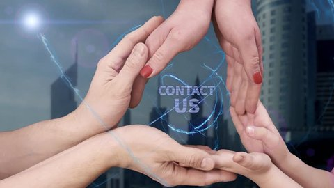 Men's, women's and children's hands show a hologram Contact us. The family holds a magical inscription on the background of a modern city