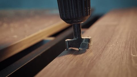 Drilling hole in the tree cutter. Slow motion shooting. Production of furniture