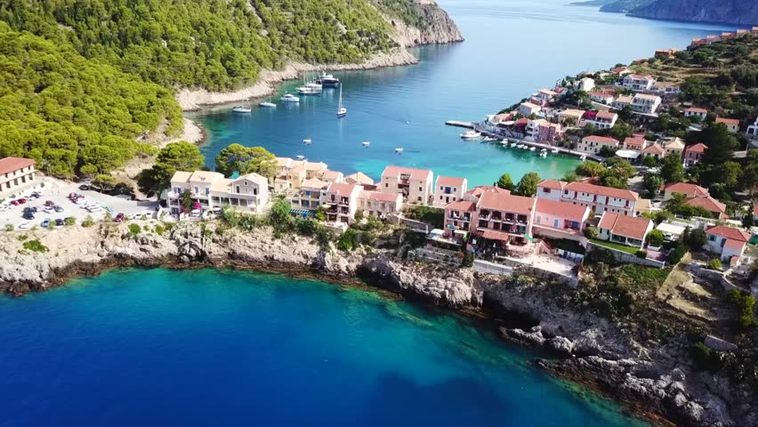 Aerial drone bird's eye view video of beautiful and picturesque colorful traditional fishing village of Assos in island of Cefalonia, Ionian, Greece #1014451433