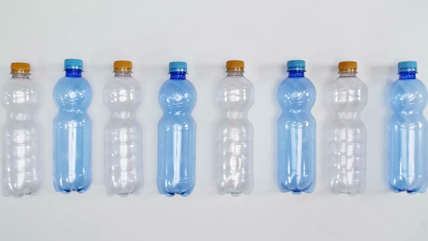 Plastic bottles in a row for recycling | Shutterstock HD Video #1014467753