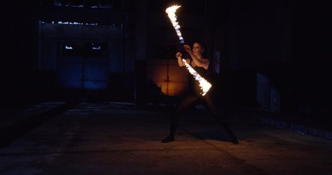 Beautiful Female Model Performing Fire Show In Darkness Danger Risk Stunt Artist Low Light Slow Motion 8k Red Epic