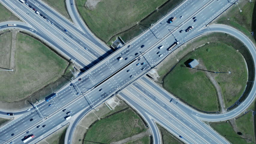 The web of roads. The infinite movement of cars. Automobile flow of a large city. Huge traffic flow. Aerial shot. 4K. | Shutterstock HD Video #1014507773