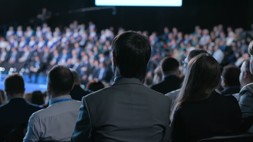 Crowd at banking congress for development idea of sales or leadership. Information for cooperation solution of entrepreneur. Full row of seats or chairs in modern large place for listener or spectator   Shutterstock HD Video #1014553223