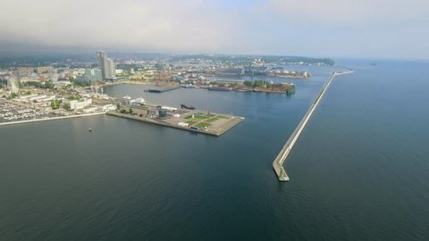 4K video. Aerial view. entering the Gdynia  industrial port and shipping harbour shot from a ferry in the early morning, Gdynia-Poland.