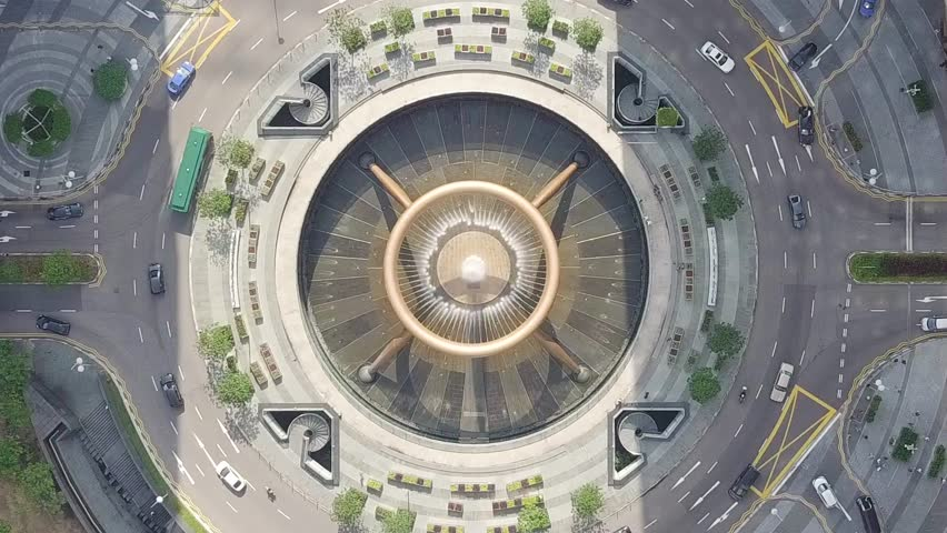 Drone view fly over the Singapore landmark financial business district with skyscraper. Fountain of Wealth at Suntec city in Singapore. 4K UHD Camera Motion circle of traffic in center of business.
