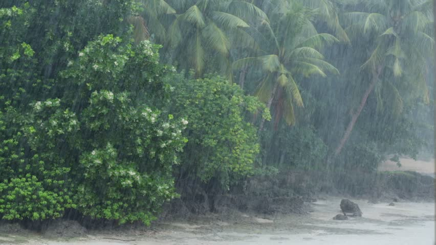 Slow motion of a heavy tropical rain at monsoon time over the wild coastline of Hatta island in Maluku archipelago, Indonesia