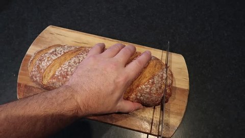 Cutting slices off a bread stick