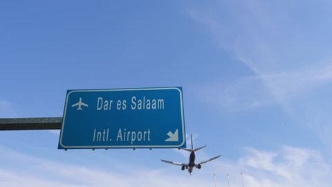 dar es salaam airport sign airplane passing overhead