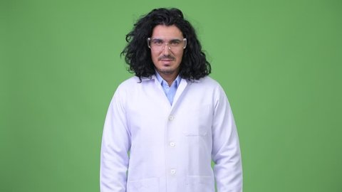 Crazy scientist wearing protective glasses with arms crossed