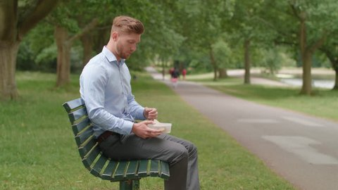 Man Eats Lunch on Bench and Experiences An Upset Stomach
