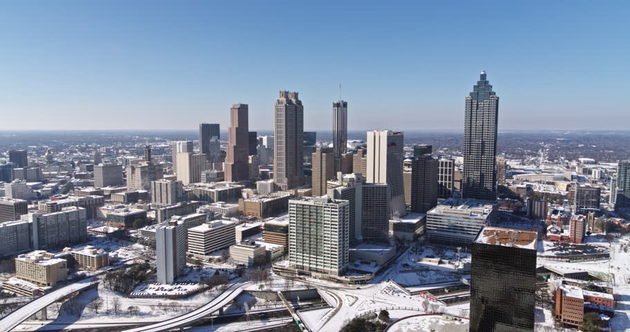 Atlanta Aerial v397 Panning low around downtown cityscape snow view 1/18