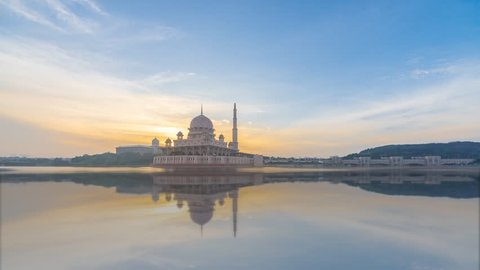 Sunrise Time Lapse at Putra Mosque by a lake in Putrajaya, Malaysia at dawn from night to day with reflection. 4KUHD.